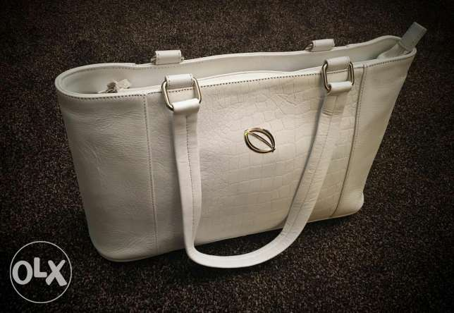 Selling my new and unused leather bag for half price.