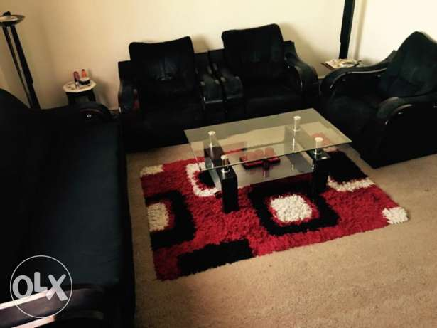 6 seater sofa set with black fabric cushions
