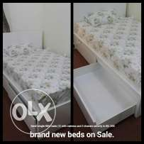 2 IKEA beds with matress and drawers.
