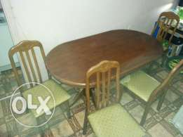 Dinning table with 4 chairs and dumbbell.