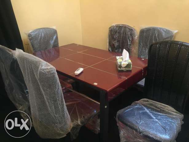 Sofa,Dining table, chairs,Table and rug