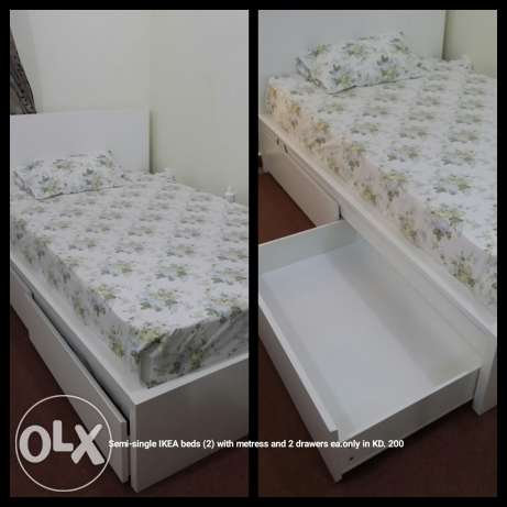 Ikea semi single beds with matress & 2 storage drawers,very less used