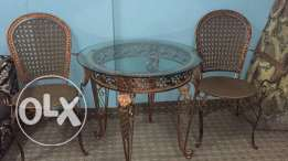 round metal table with metal chairs in good condition