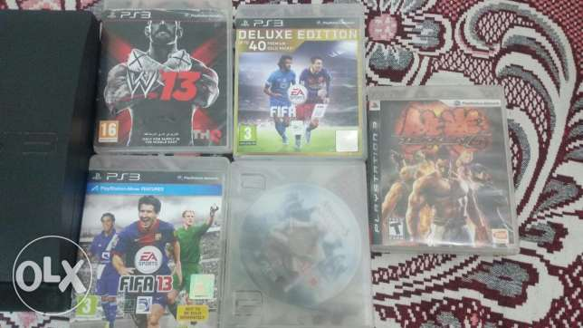 PlayStation 3 with camera (Box and 7 games)