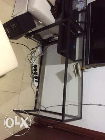 Ikea glass office table used as tv table KD 6 each piece ( two pieces