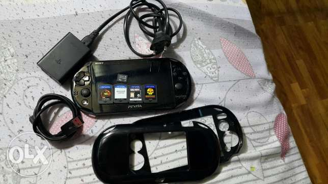 Ps vita slim with 4 games and two memory card 8gb and 4g