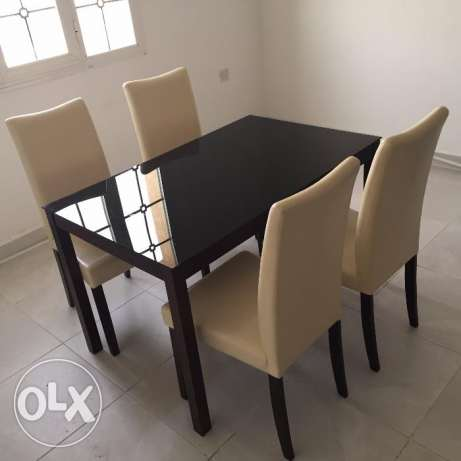 Dining Table with Glass top (4 cusioned chair) SAFAT Make 55 KWD
