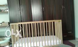 Excellent IKEA baby cot, mattress and sheets سرير رضع