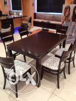 Dinning table with six chairs purchased from Safat Alghanim.