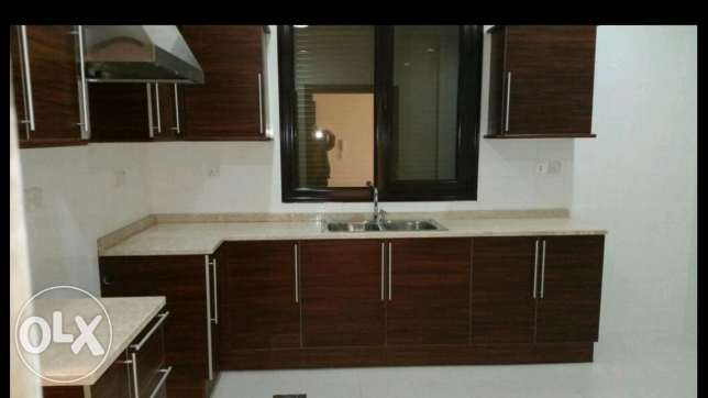 Bayan Brand new flat 4 bedrooms with maid room