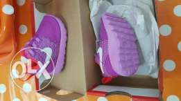 2 brand new Nike baby shoes