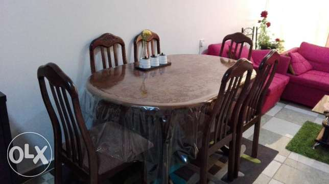 Wooden dining table with 6 chairs available for sale