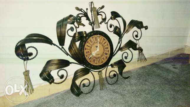The wall clock/antique metal work frame!!