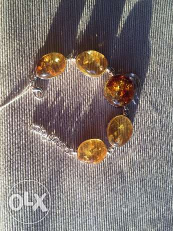 Silver bracelets with amber