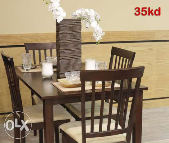 Almost new dining table 4 seater with seating cover from safat home
