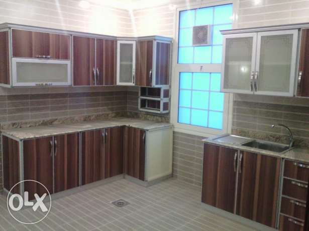 Private duplex villa with basement, garden & pool in abu al hasaniya.