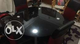black round glass dining table with 4 chair