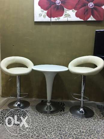 Leather bar stools with round table