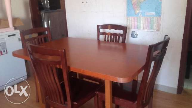 full wooden Dining table with 4 chairs - KD 25