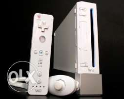 Wii console, Remote controller, Nunchuk unit & Balance Board with some