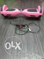 Original hover board ,pink in colour with its chager, used only for o
