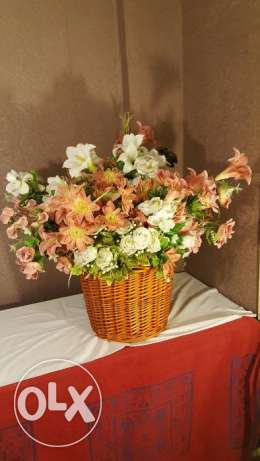 Large flower basket with decorative artificial flowers