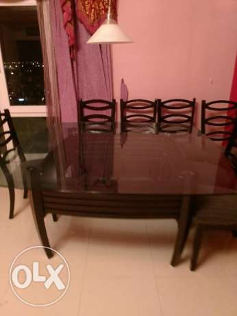 8 seater glass top dining table for