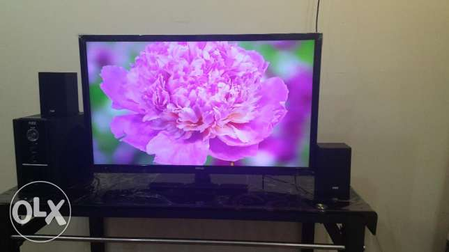 """Wansa 32"""" LED with NHE home theatre in good condition for sale."""