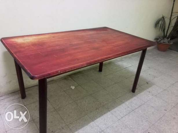 Maroon wooden dinning table for urgent sale