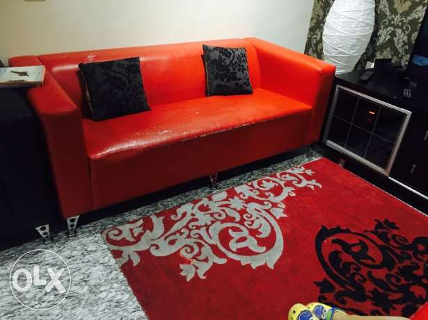 3+2 sofa seater with a matching rug