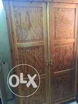 Selling a single wooden cupboard and a single wooden bed