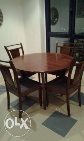 Round dining table (1m 20cm) + 4 matching chairs(Safat Homes)- 35 KD