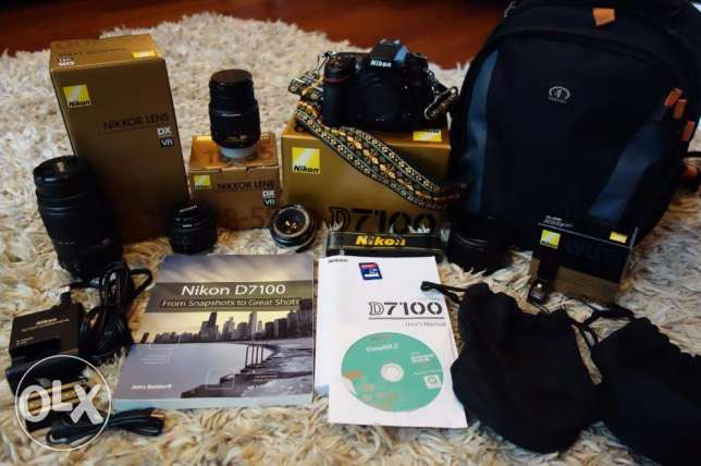 nikon d7100 24 mp digital slr camera with 4 lenses