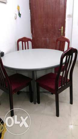 Round Dinner table and 4 wooden chairs