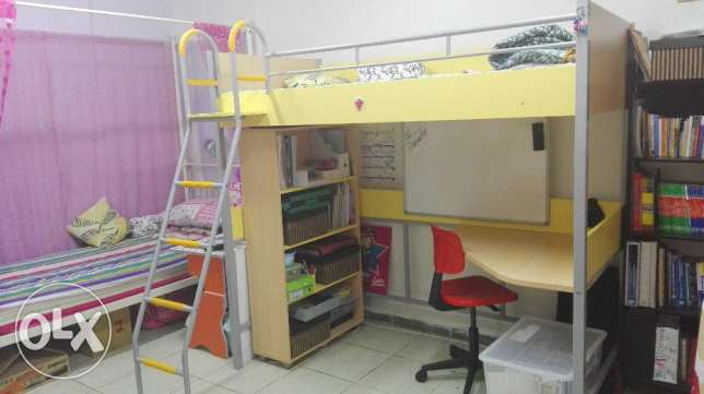 Bed-cum-studytable set with small wardrobe available for sale