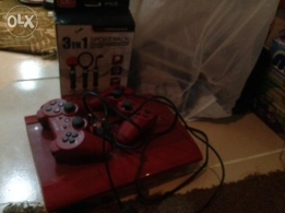PS3 with 2 controlers and games CDs