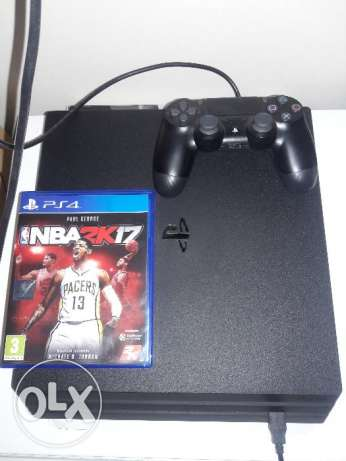 PS4 PRO Console (1 TB) Plus 1 game NBA2K17