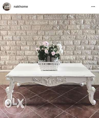 white carved wood coffee center table