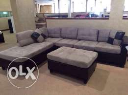7 seater L shaped couch with table and carpet