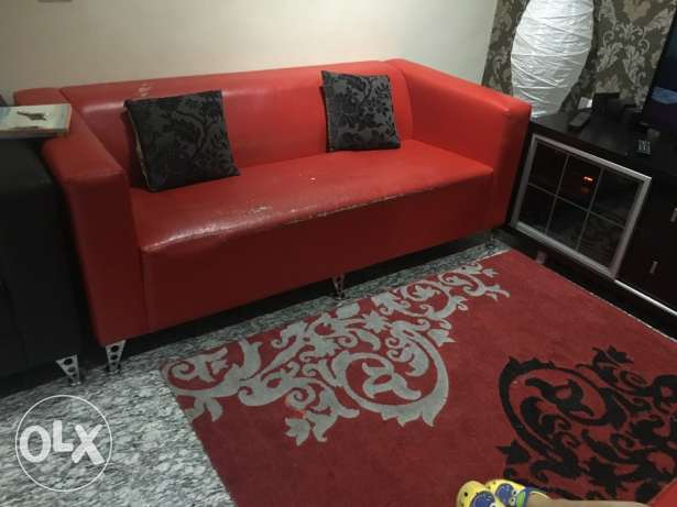 3+2 leather sofa set in red, with a matching rug