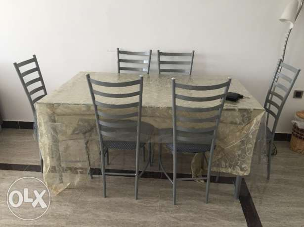 Glass dining table with six seats