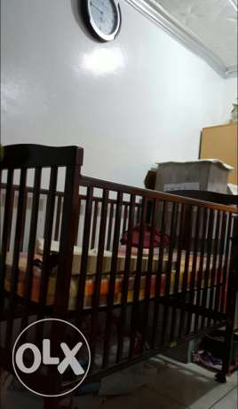 Baby cot by Juniors rarely used in excellent condition for sale