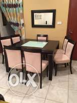 Table with 8 chair and cabinet