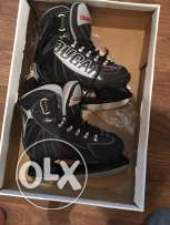 Ice skates by cougar