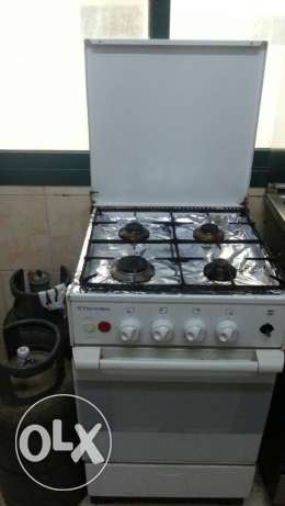 2 gas cylinder and 4 burner with oven
