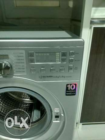 Samsung washing machine with dryer for sale at throw away price.