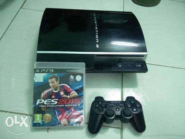 Sony ps3 with 1 game and 1 remote