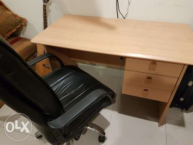 Desk and rolling leather chair